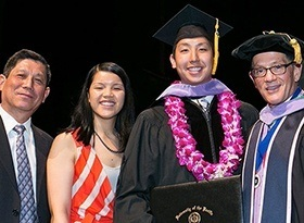Dr. Tran and his family at graduation