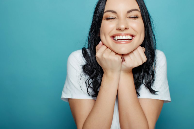 young woman smiling and laughing
